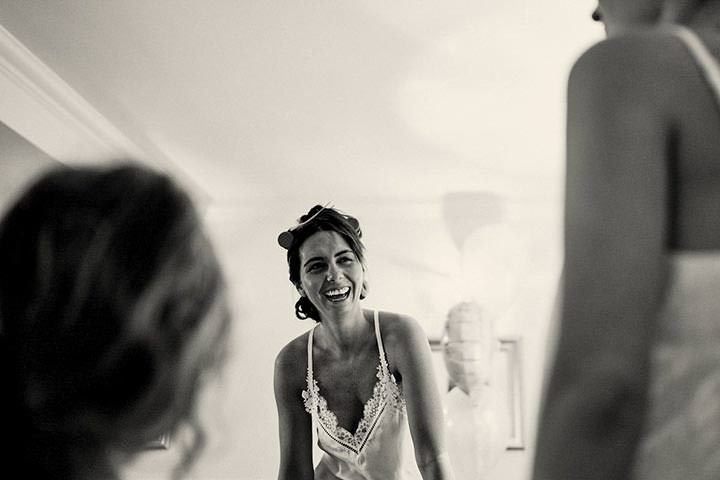 Bride laughing on wedding morning