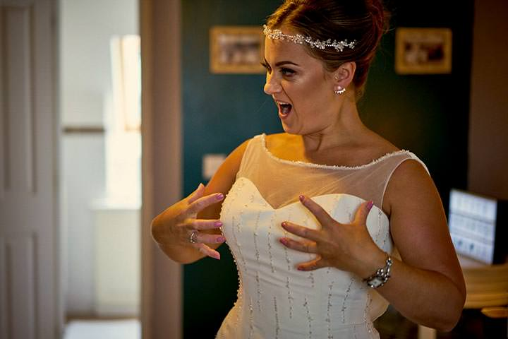 Bride making gesture about her boobs