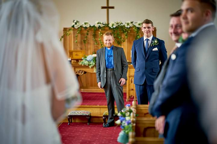 Grooms reactiont to seeing bride walking down the aisle
