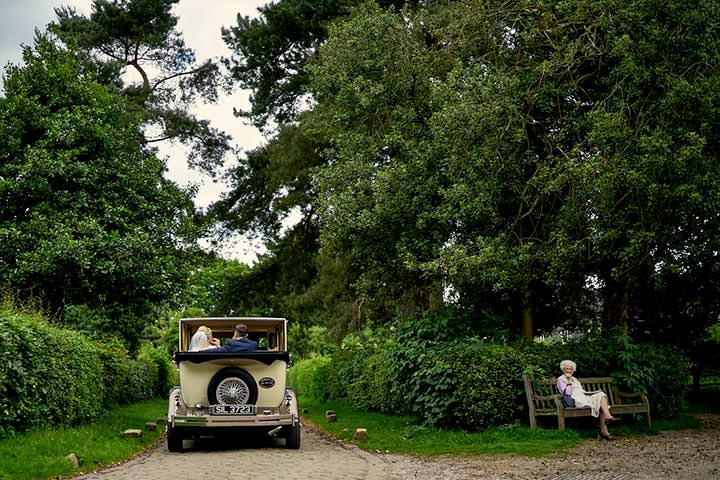 Bride & groom leaving in vintage car