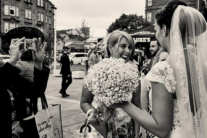 Bride outside with wedding guest after wedding at St Luke's Glasgow