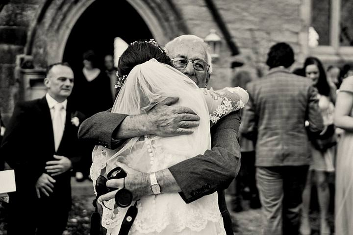 Granddad giving bride a hug