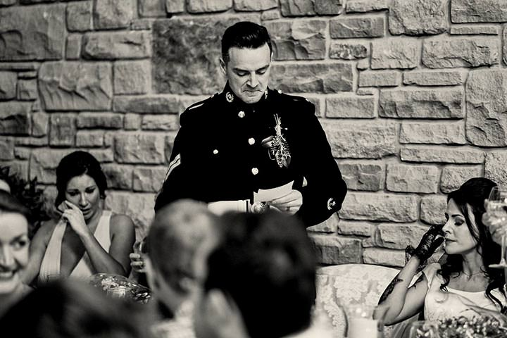 Groom holding back tears during speech