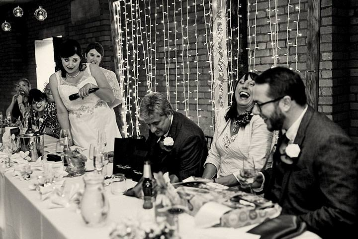 Everyone laughing at bride's speech
