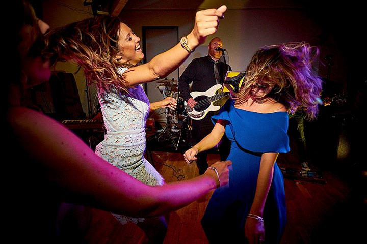 Wedding guests happy dancing with hair flicks