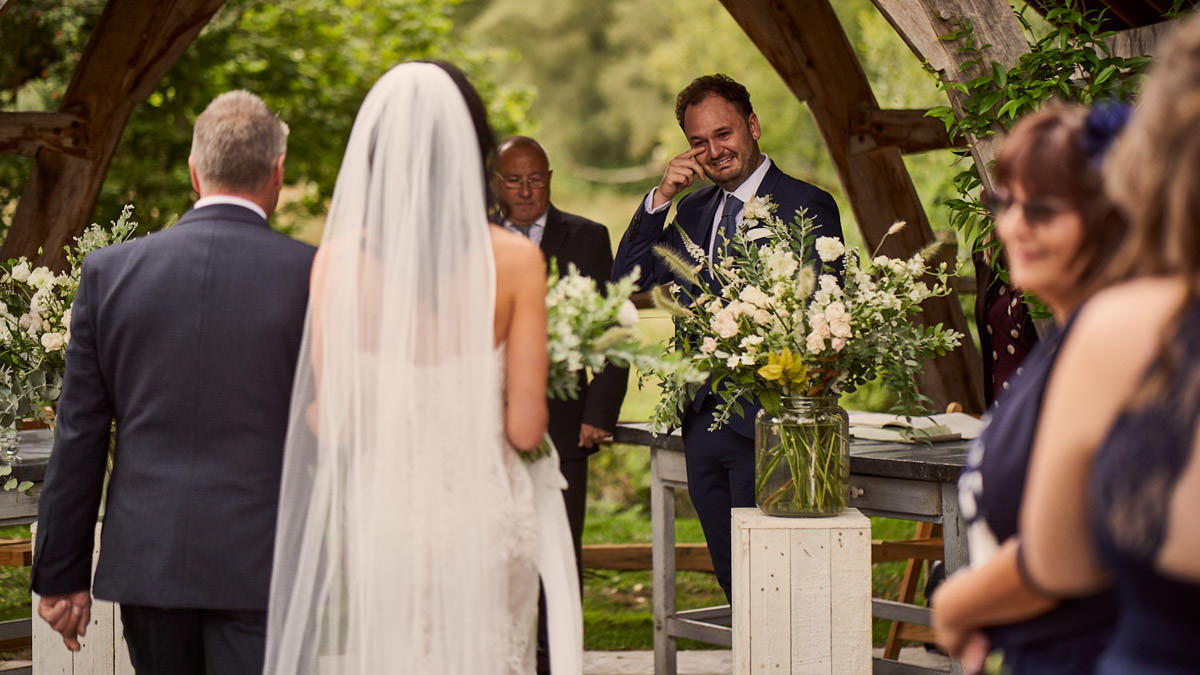 Groom crying when Bride walks down the aisle
