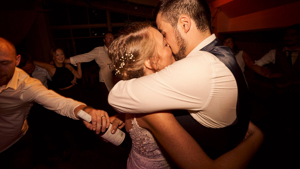 Bride & Groom kissing at the end of the night