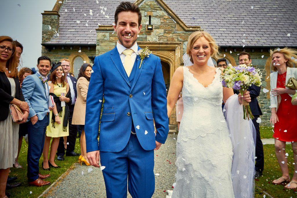 Bride & Groom Confetti Outside St Ffraid's Church Anglesey