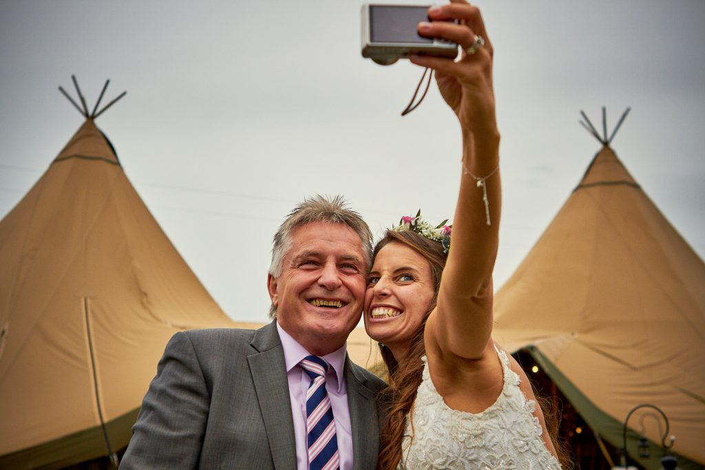 Bride Taking A Selfie With Bridesmaid's Father
