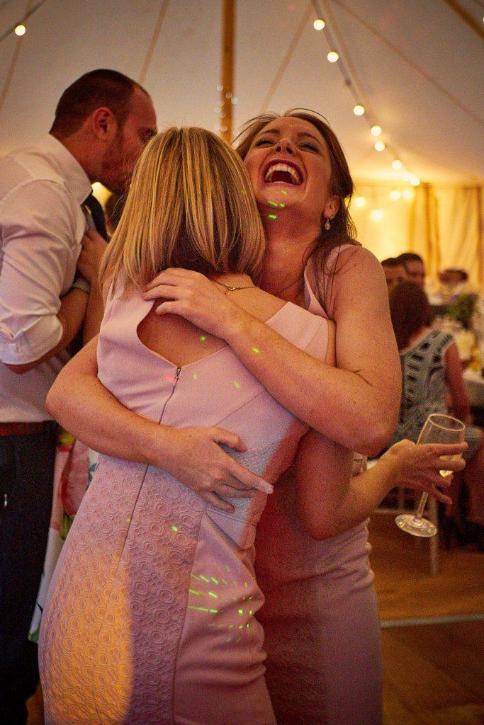 Bridesmaids hugging and laughing