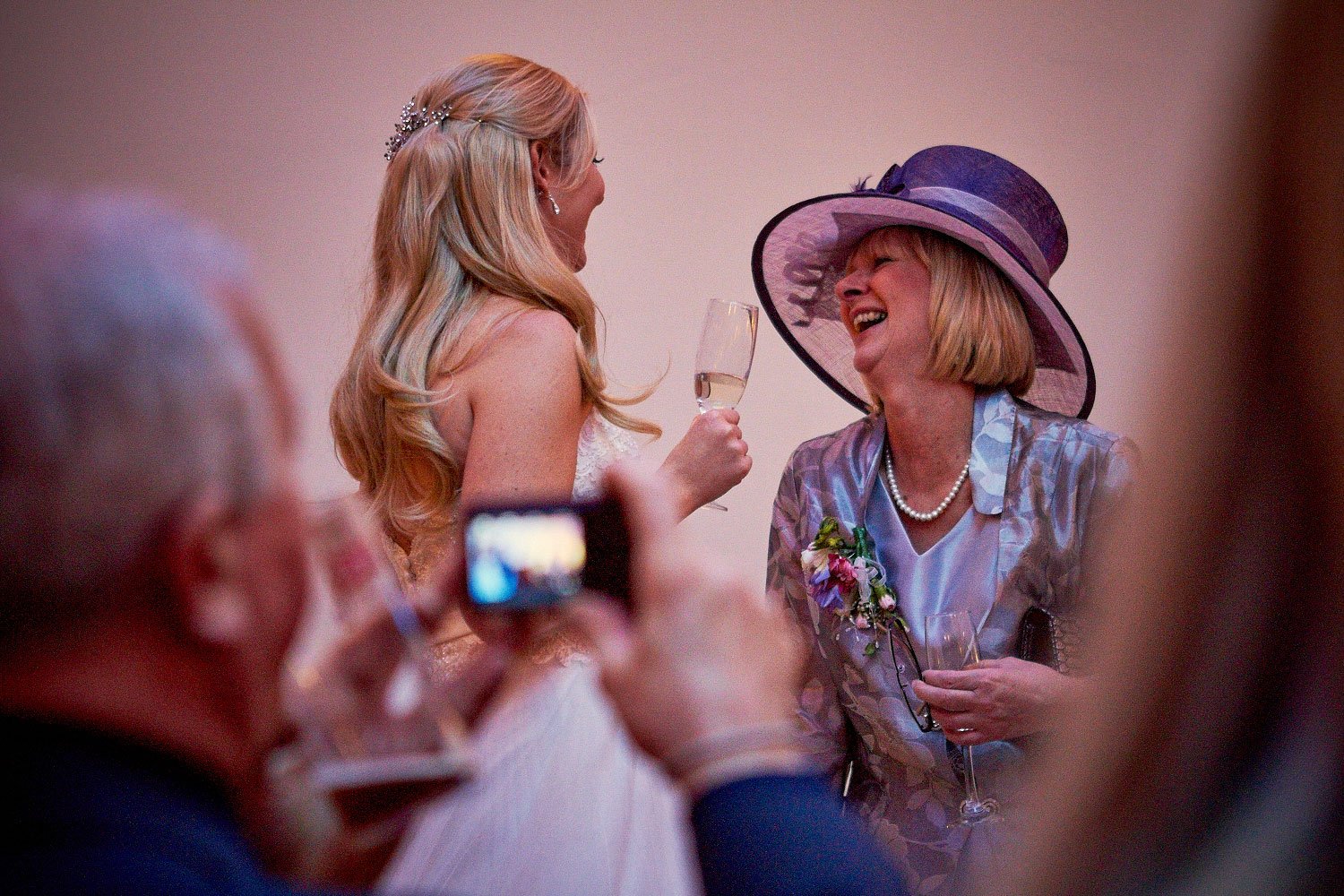 Bride laughing with mother of the bride