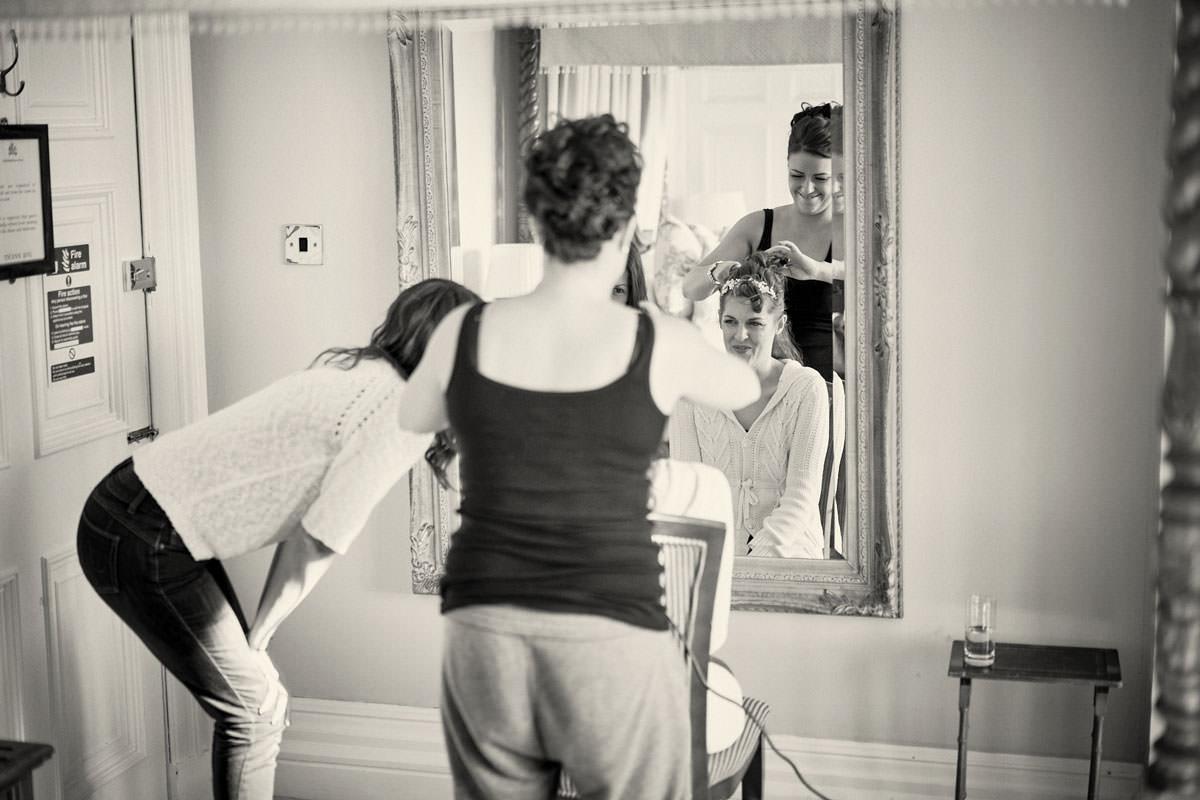 bride in front of bridal suite mirror
