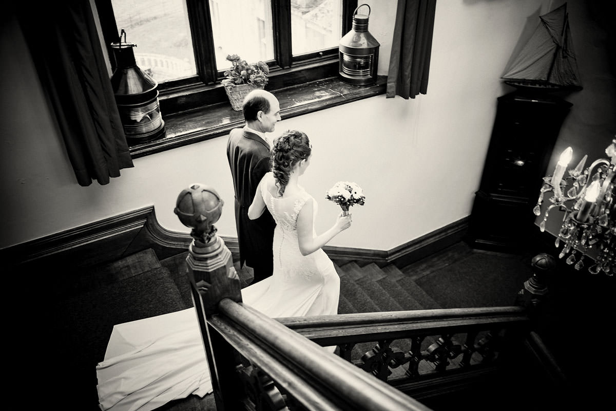 bride and father of the bride walking down the stairs
