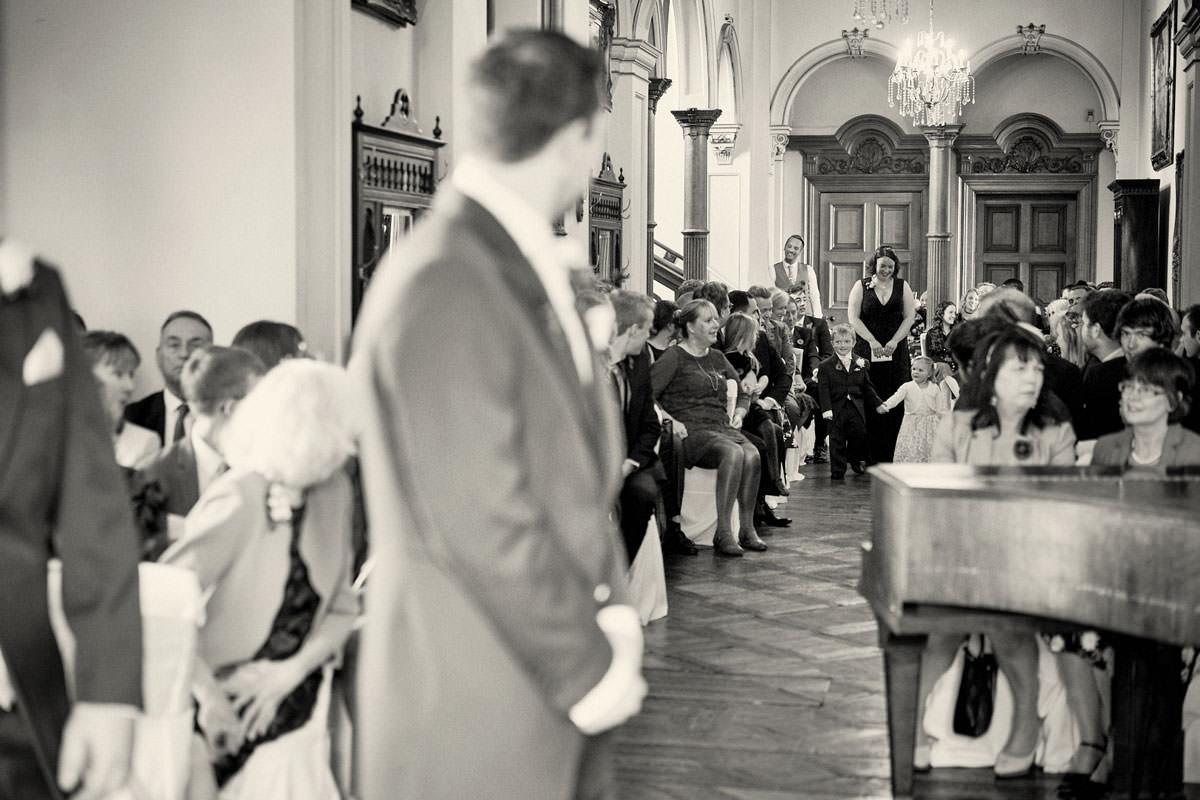 bride & grooms children walking down the aisle
