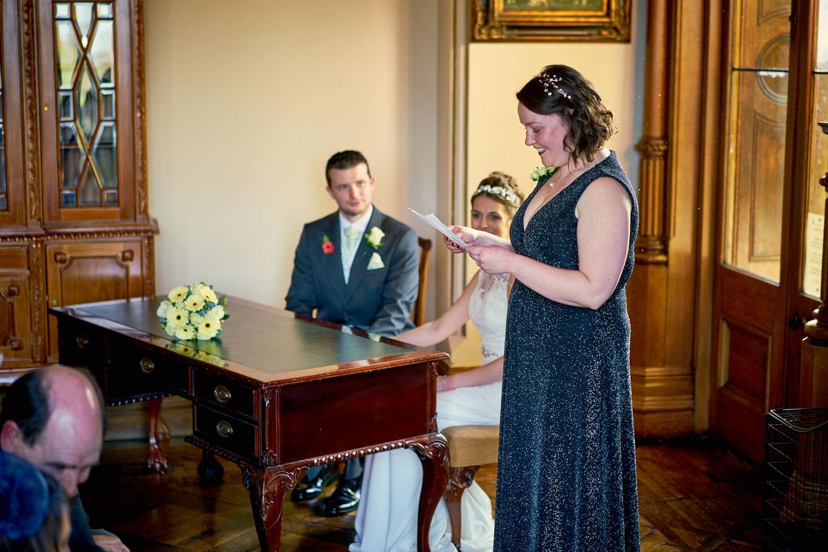 bridesmaid making a reading