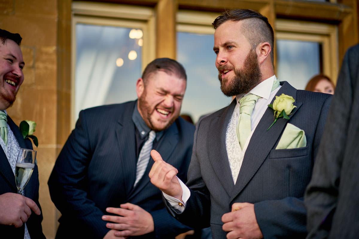 guests joking at wedding