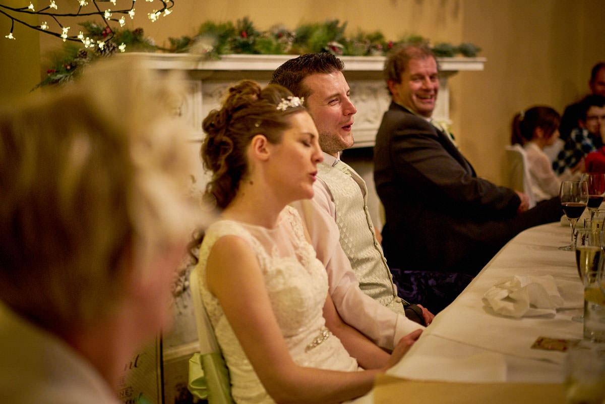 bride & grooms reaction to bad joke
