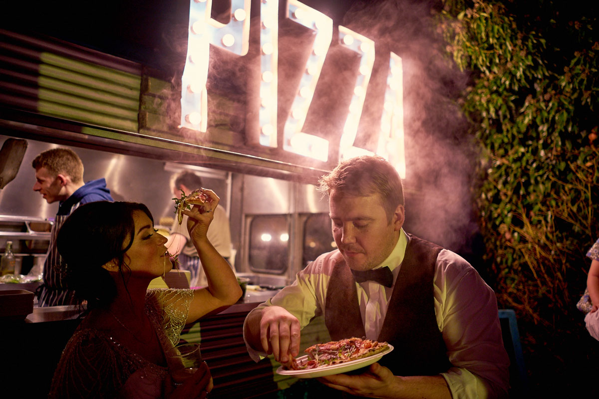 bride and groom eating pizza peddler pizza