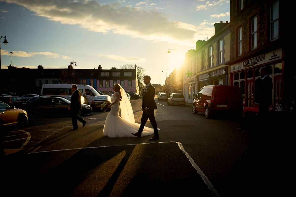 bride and groom walking across the road in castletownbere