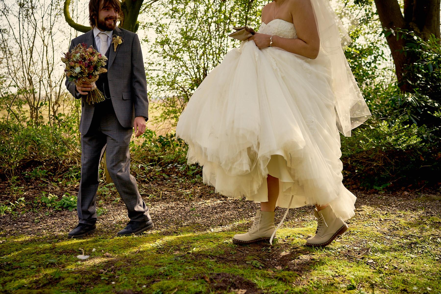 bride holding up her dress showing her doc martens off