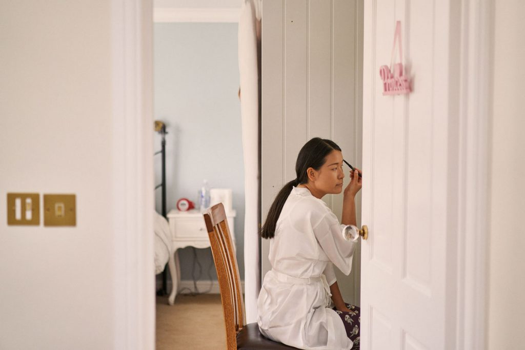 Bride doing her own make-up at home