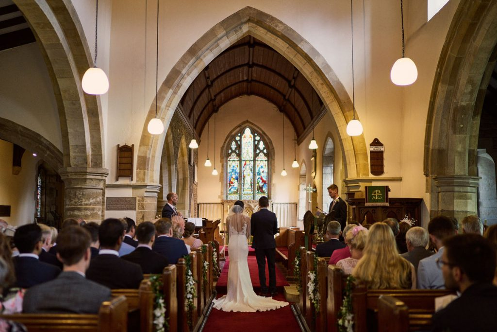 Bride & Groom stand together in Yorkshire church