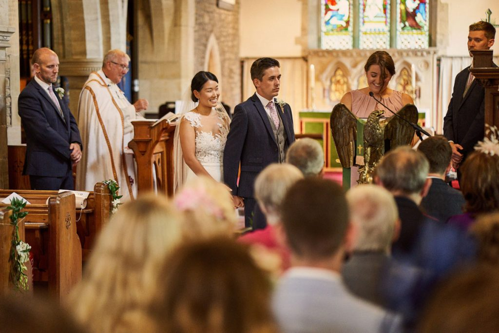 Bridesmaid makes an emotional reading during wedding ceremony