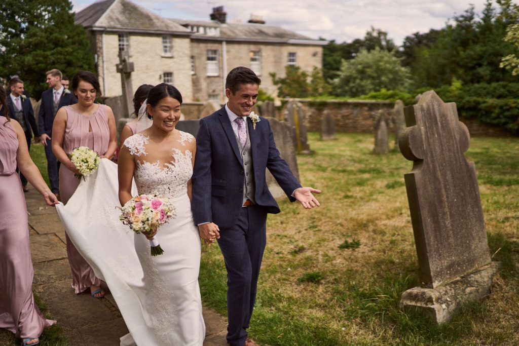 Bride & Groom looking happy as they leave the church