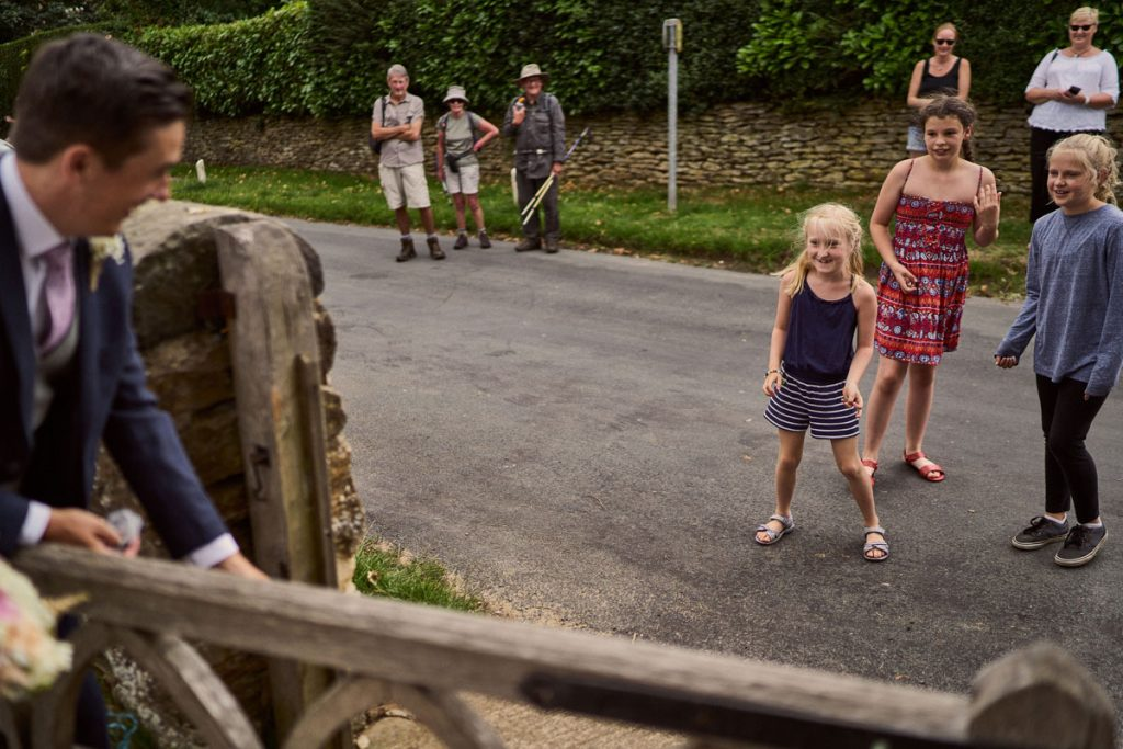 village locals gather outside the church after tying the church gates