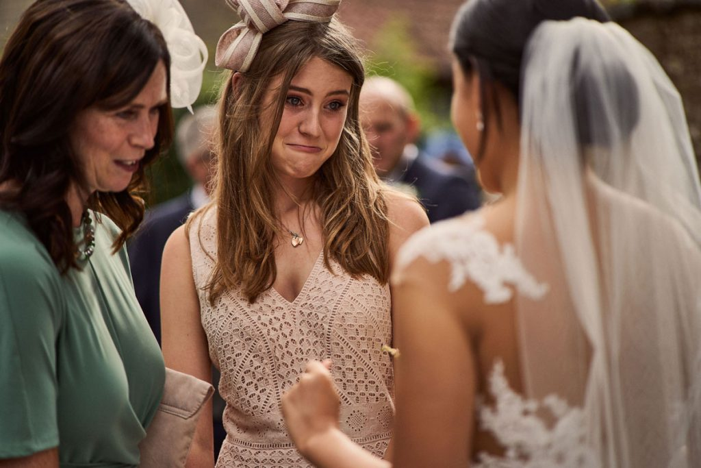 wedding guest looking emotional after wedding