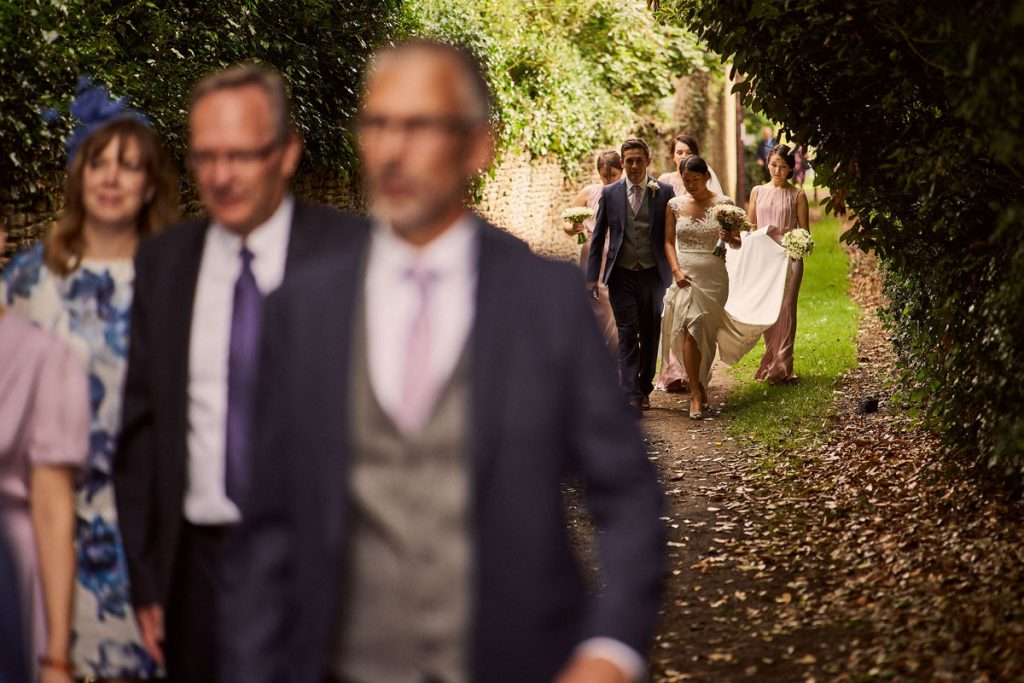Bride & Groom. walking down country lane on the way to their tipi wedding reception
