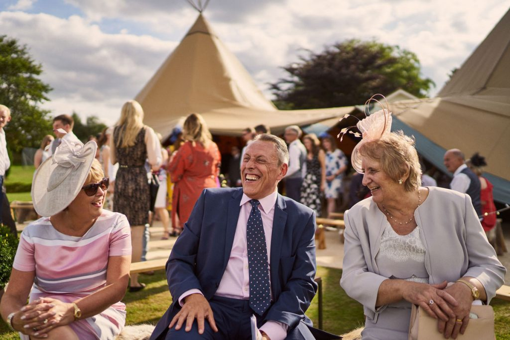wedding guest laughing in the Yorkshire sunshine.