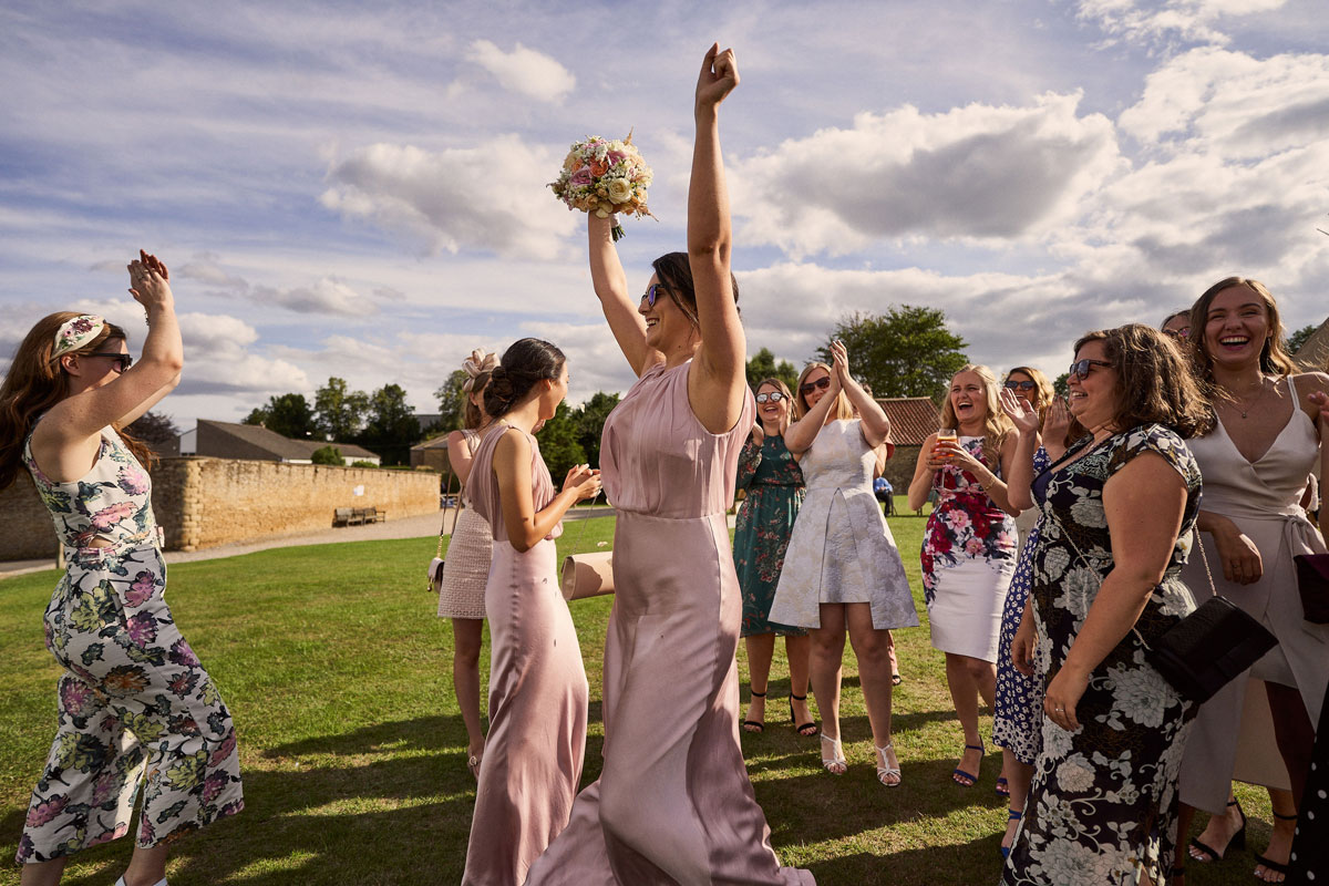 Bridesmaids celebrating after catching the bouquet