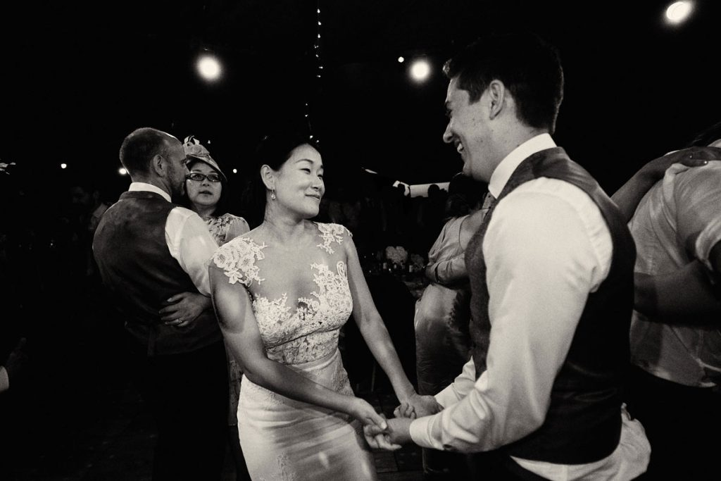 Bride & Groom holding hand during first dance