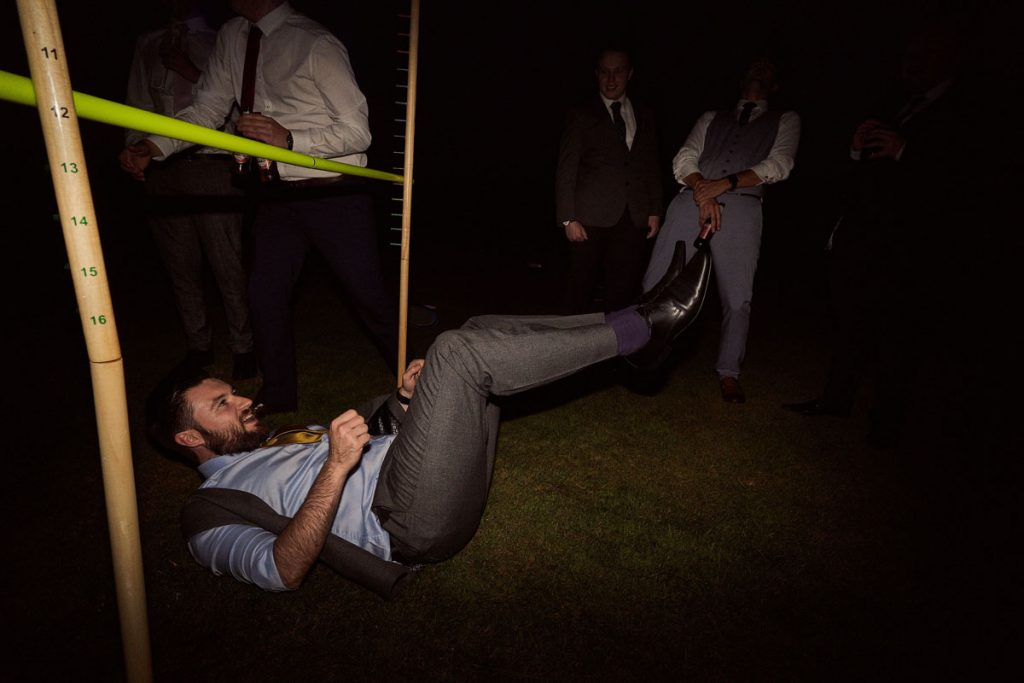 wedding guest falling over trying to limbo drunk