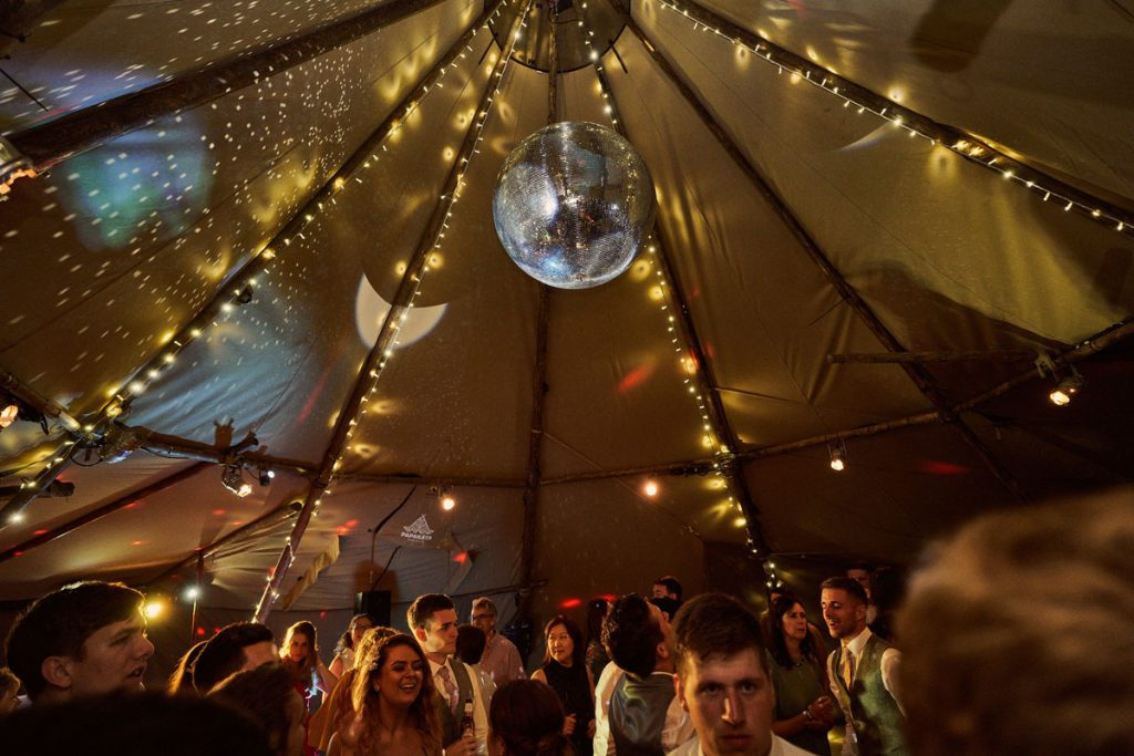disco ball reflections in wedding tipi