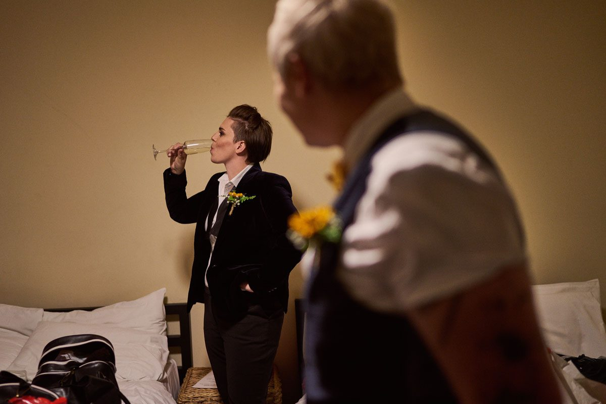 Bride drinking Prosecco to calm her nerves before the wedding