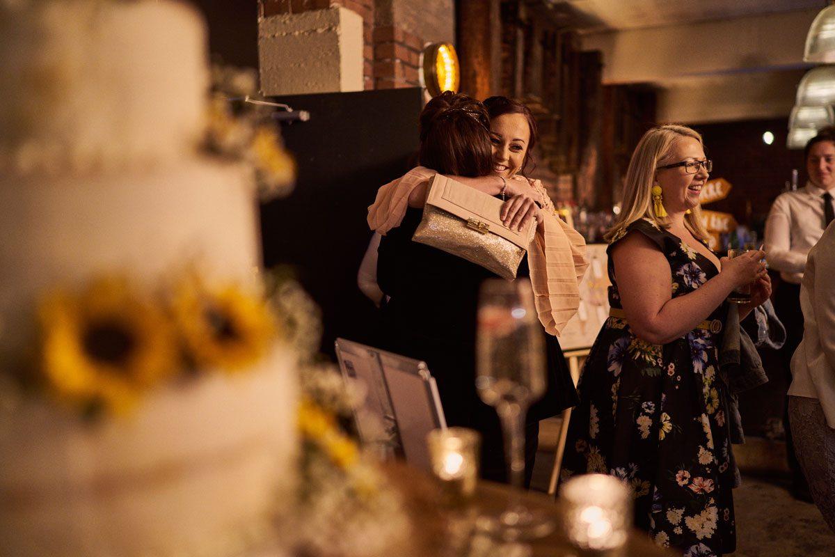 wedding guest giving Bride big hugs