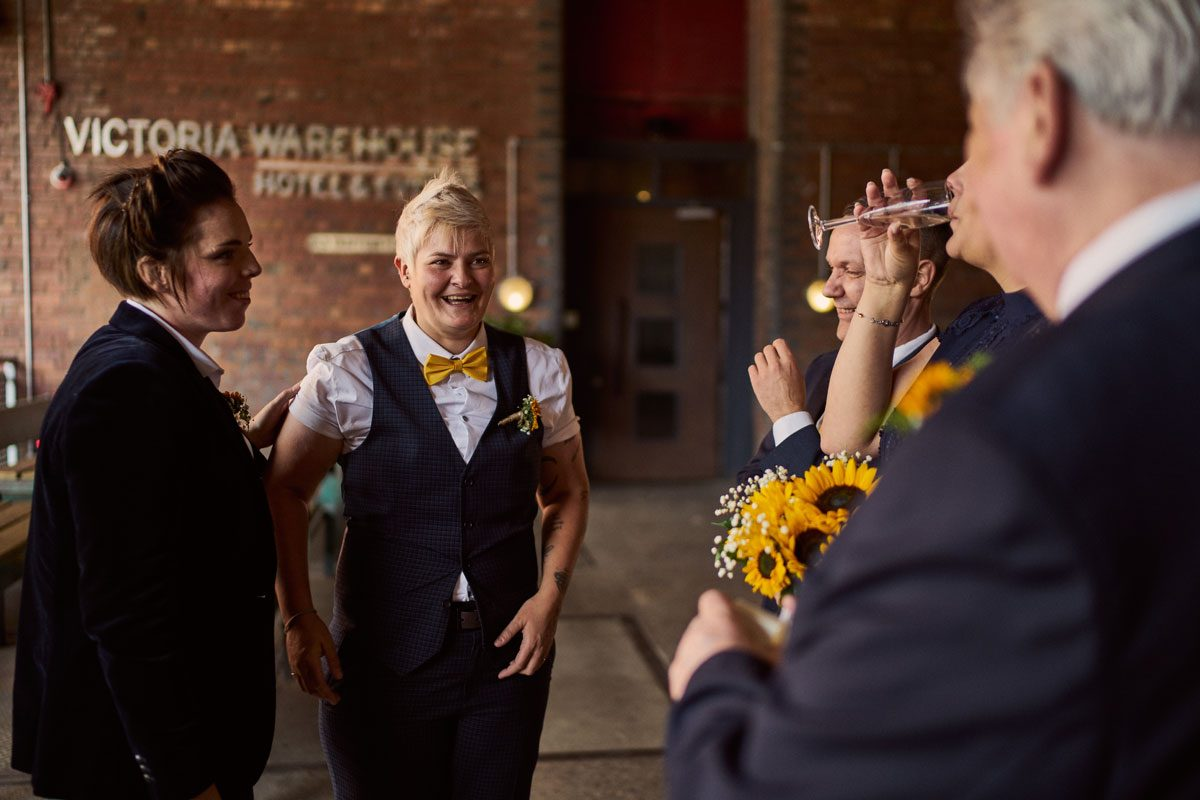 relaxed bridal party photos at the front of Victoria Warehouse