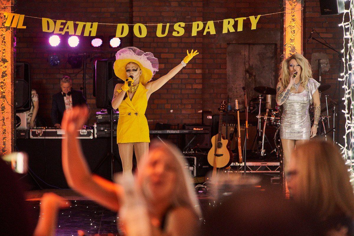 the vegan queens perform at Victoria Warehouse wedding