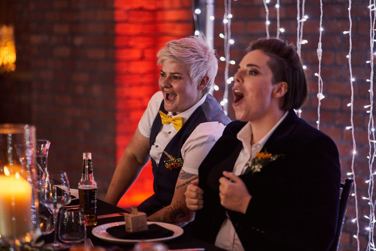 two brides sing along with the vegan queens