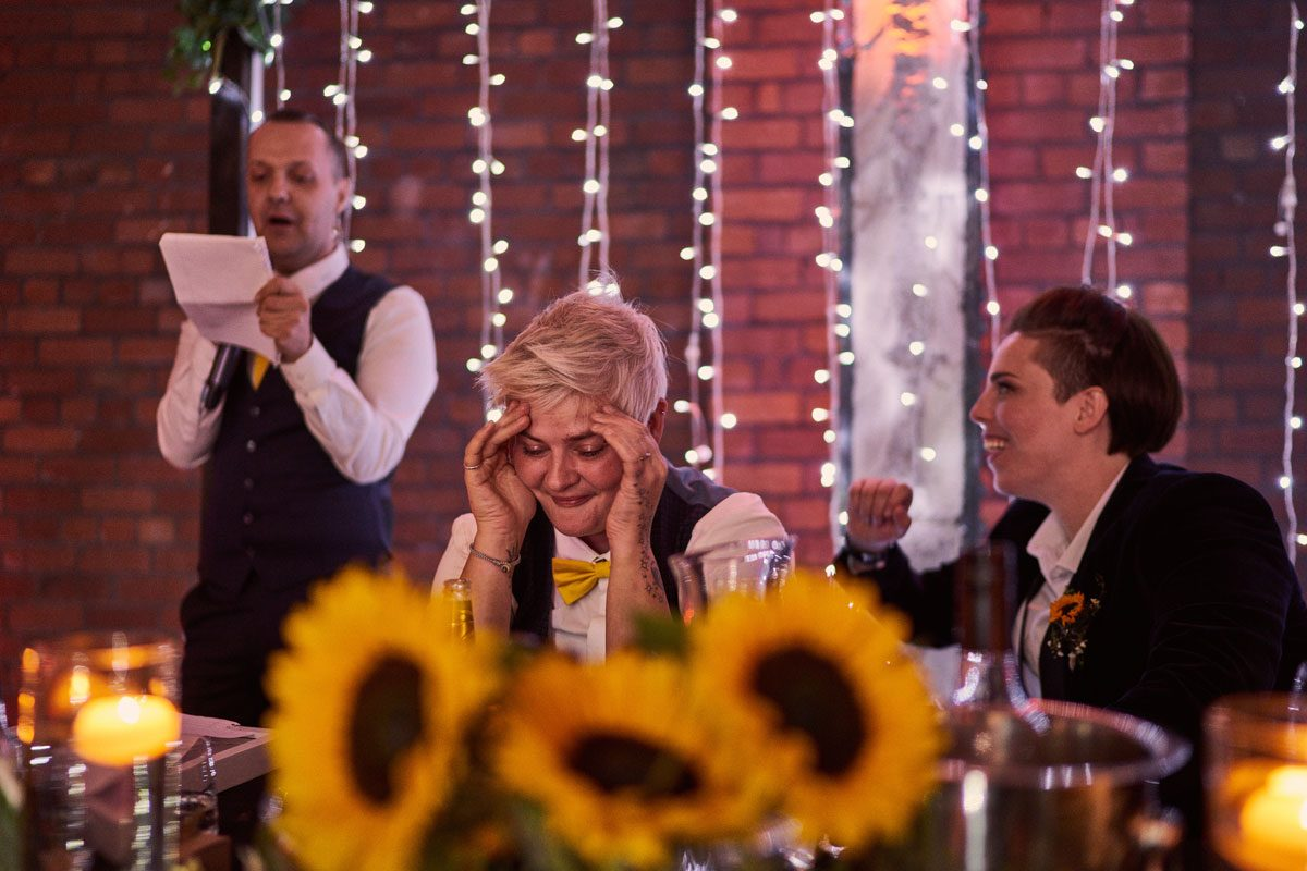Bride looking embarrassed by wedding speech