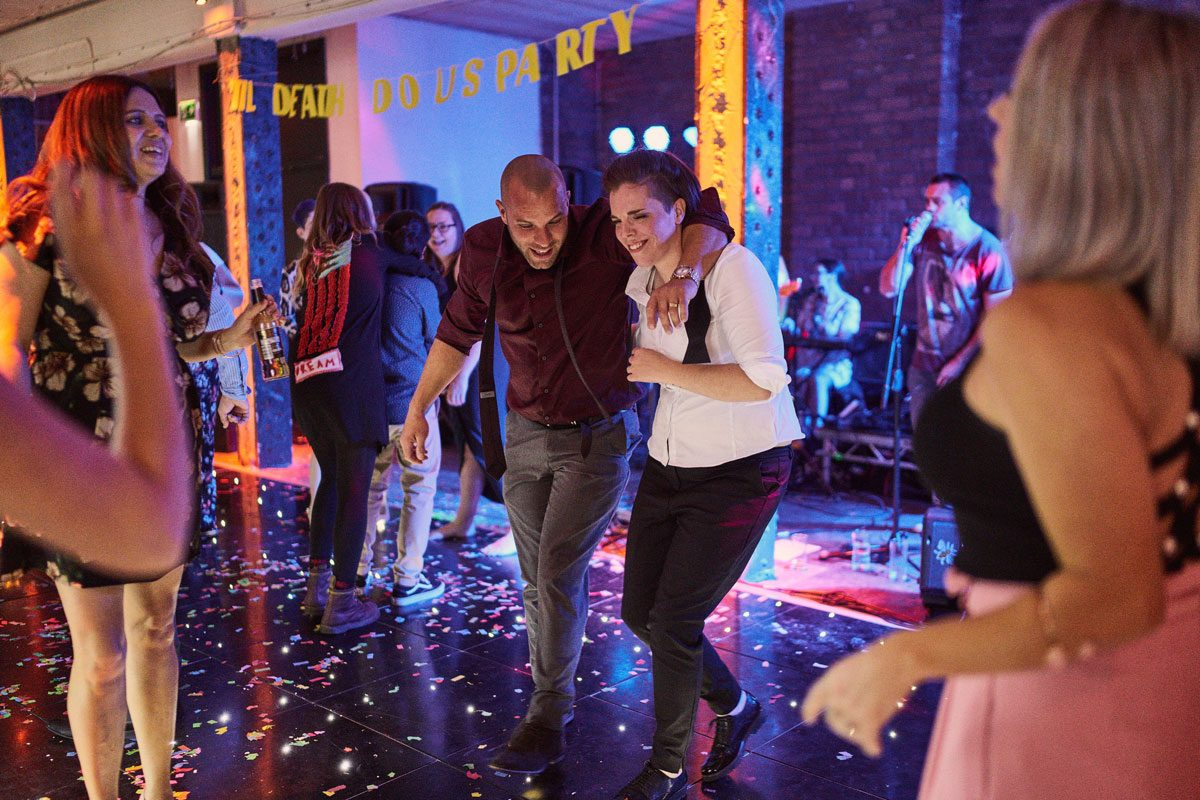 Bride dancing with her brother at Victoria Warehouse