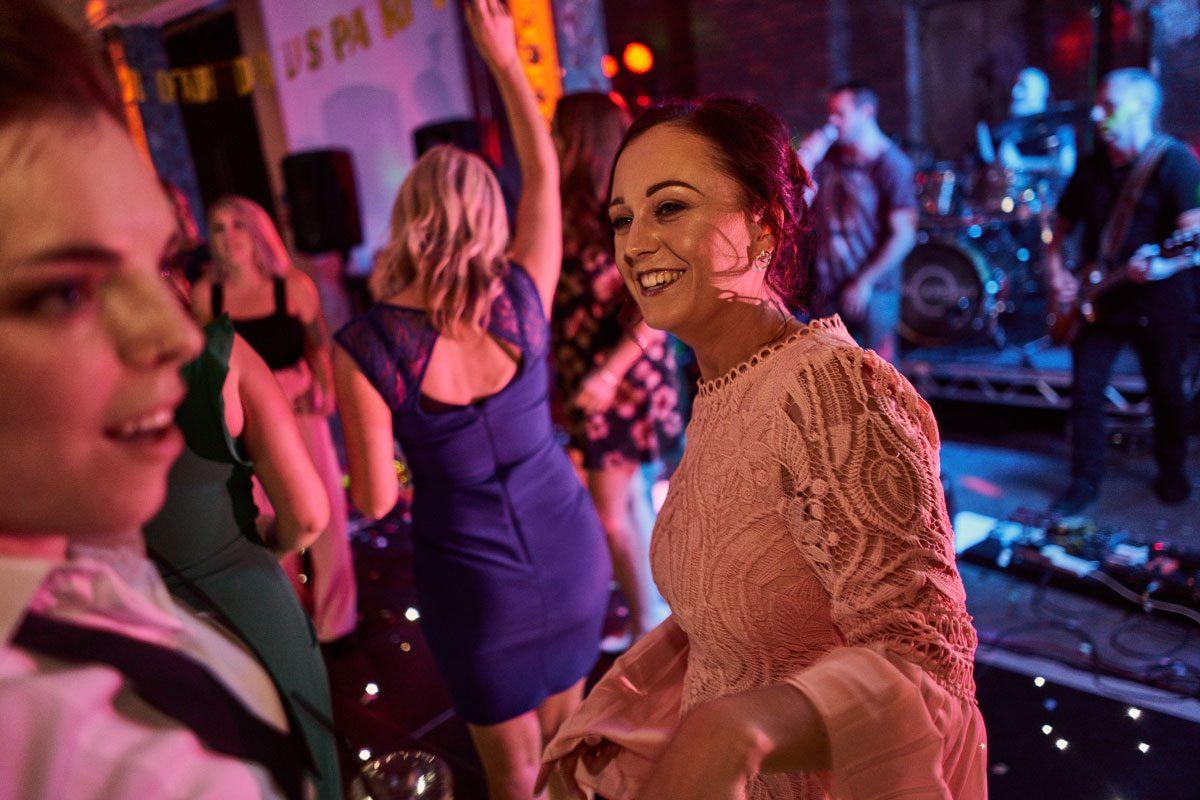 smiling wedding guest on the dance floor