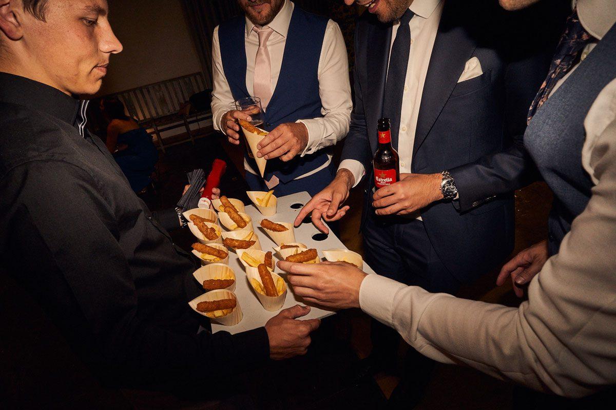 wedding guest grabbing hot dogs