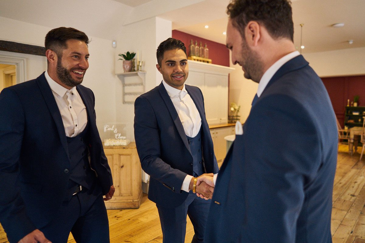 Best Man shaking hands with the groom