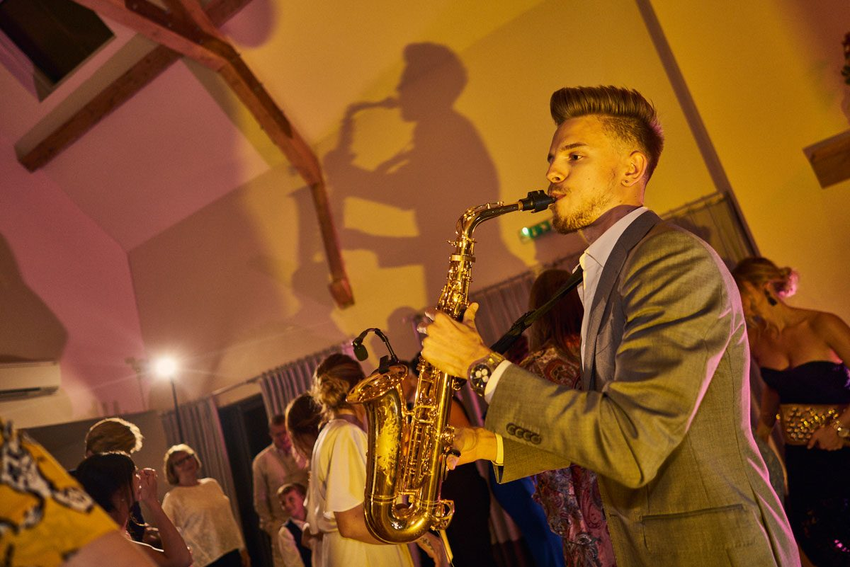 dan Goode playing sax in the evening at Millbridge Court