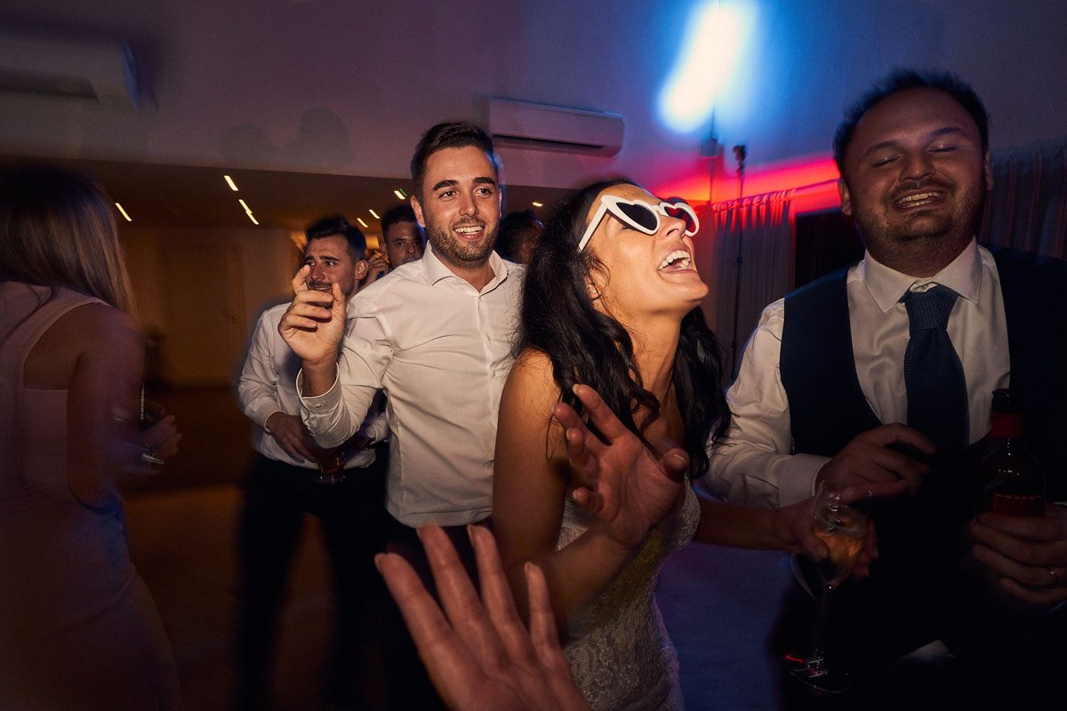 Bride dancing with sunglasses on