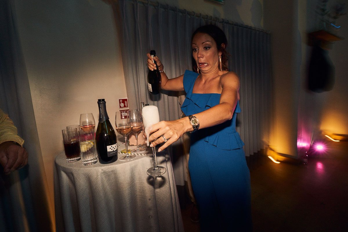 wedding guest almost spilling champagne