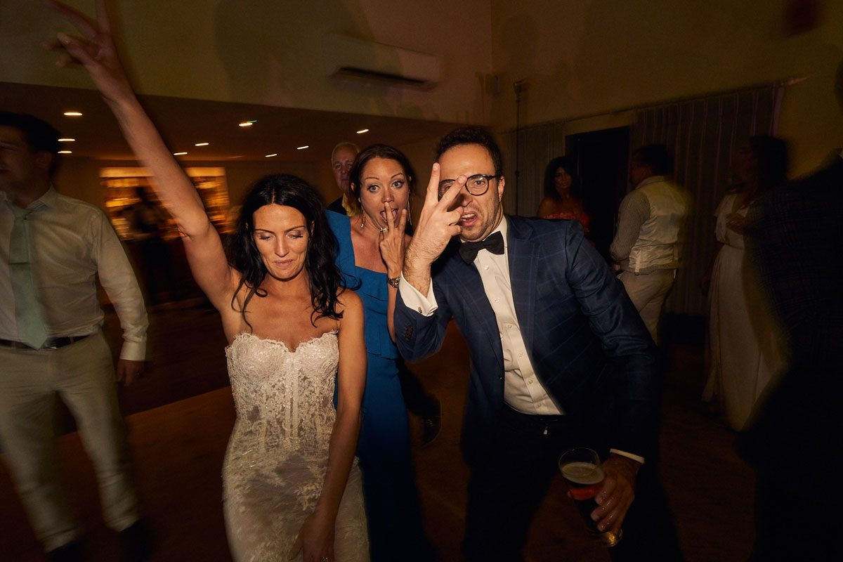 drunk wedding guest sticking his finger up to the camera